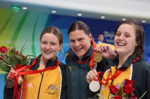 The medallists in the women's S9 100m butterfly event at the Beijing 2008 Paralympic Games. Left to right: Annabelle Williams of Australia (bronze), Natalie du Toit of South Africa (gold) and Ellie Cole of Australia (bronze).